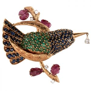 Bird Brooch from Warshawsky 18K yellow gold, contains a pear cut diamond weighing 0.20 carats, numerous round cut sapphires weighing approximately 4.00 carats total, numerous round cut emeralds
