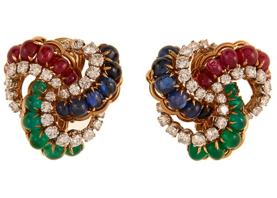 French, Circa 1960 diamond, emerald, ruby and sapphire earclip earrings 18K yellow and white gold, 60 round cut diamonds weighing approximately 4.80 carats, 12 oval cabochon cut emeralds, rubies and sapphires graduating in size measuring 5.00 x 4.00 - 3.00 x 2.00 mm