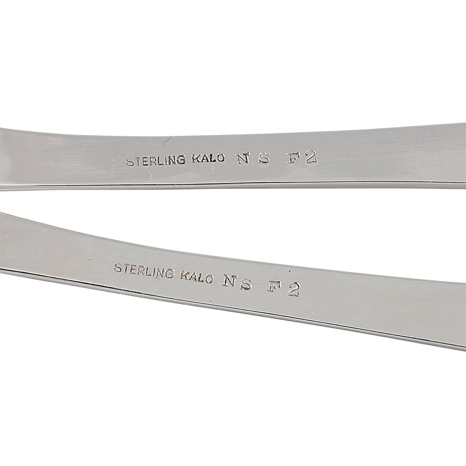 """The Kalo Shop Norse Line salad serving set, #NS F2: fork and spoon fork: 3 1/16""""w x 10 1/2""""l; spoon: 3""""w x 10 1/2""""l"""