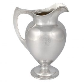 "The Kalo Shop pitcher with a raised plinth base, #E609 pitcher: 8 1/8""w x 6 1/8""d x 11""h; base: 6 3/8""dia x 1 3/4""h"